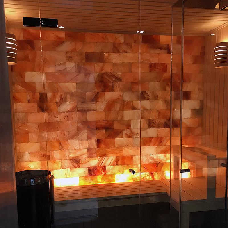 Frameless glass surrounding a sauna