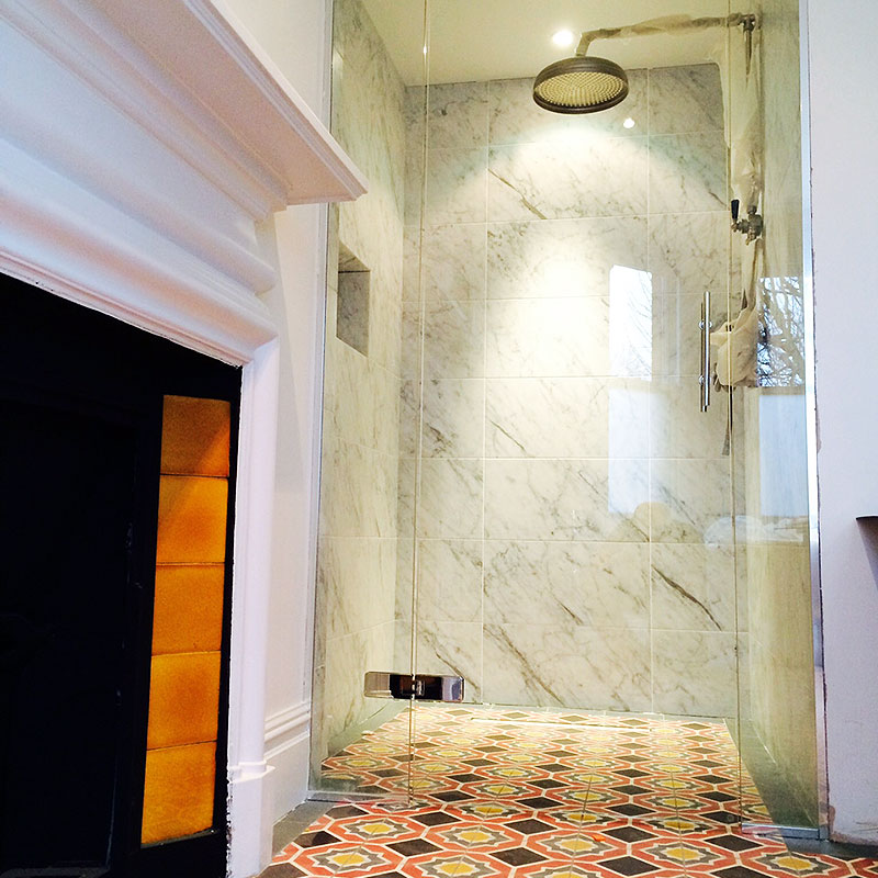 Frameless glass shower by fireplace in Richmond, London