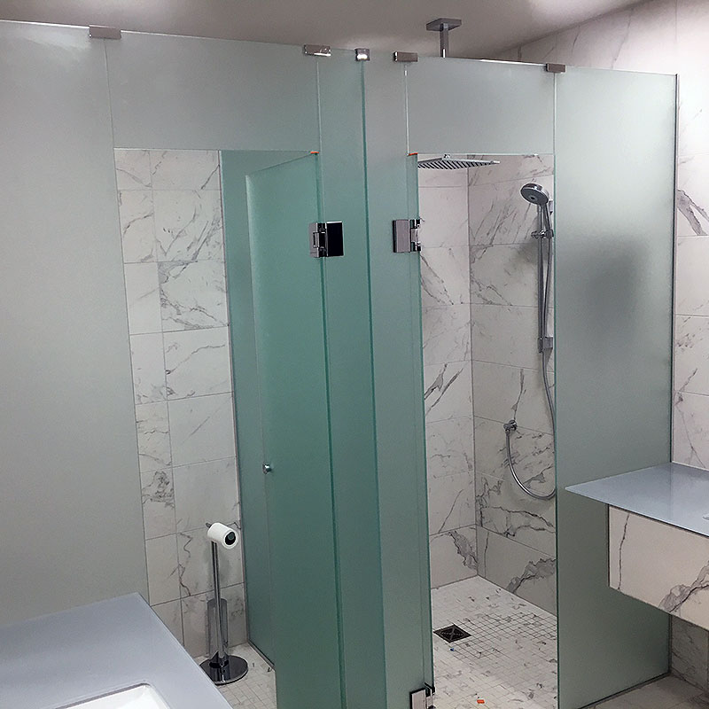 Frosted glass shower and toilet cubicles in London