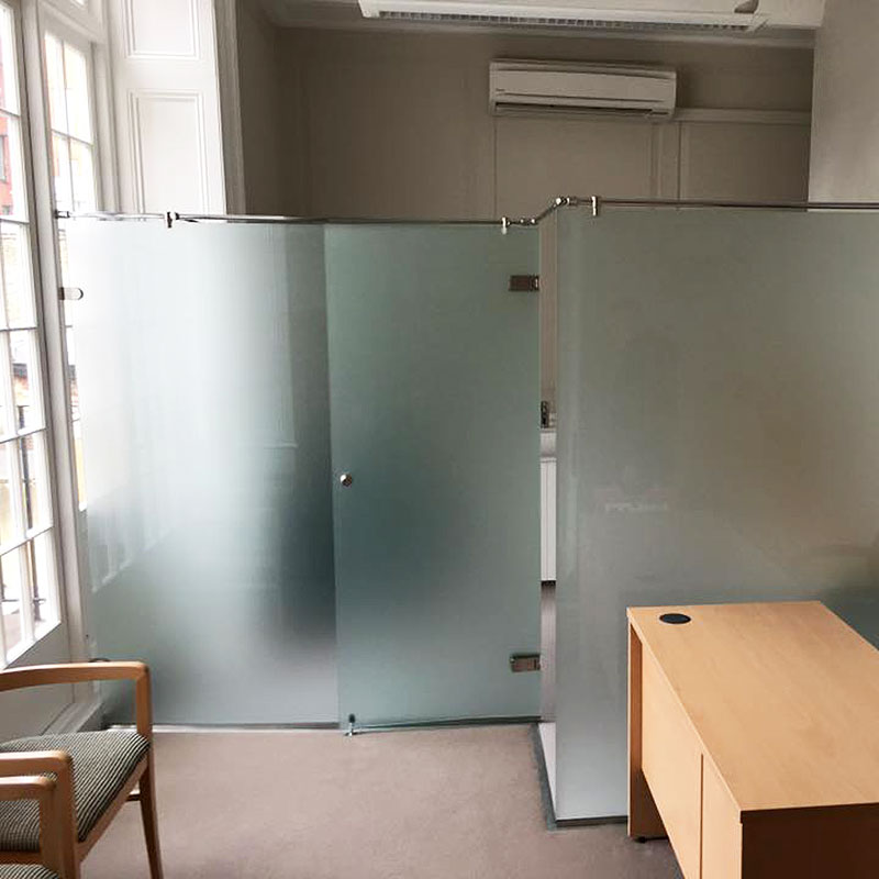 Frosted glass office partition with door