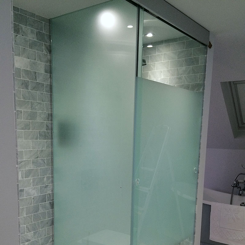 Frosted glass shower enclosure with clear glass section
