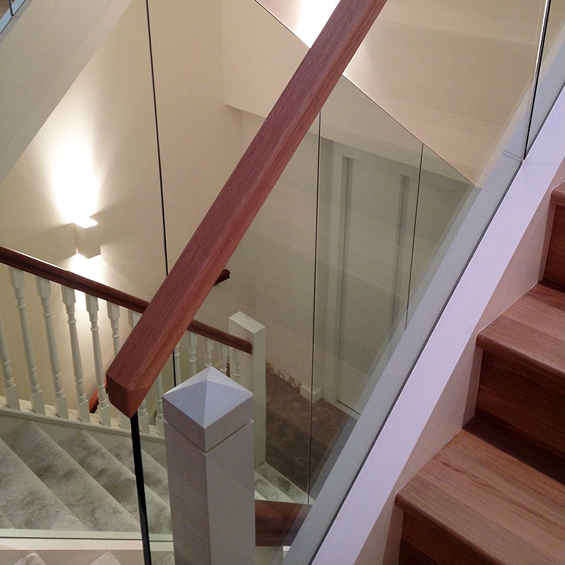 Wood and glass mixed balustrades in London home