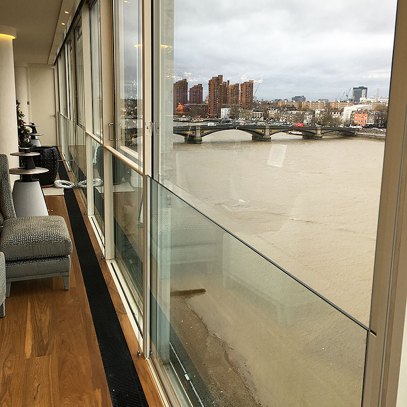 Glass safety balustrade on windows overlooking the River Thames in London