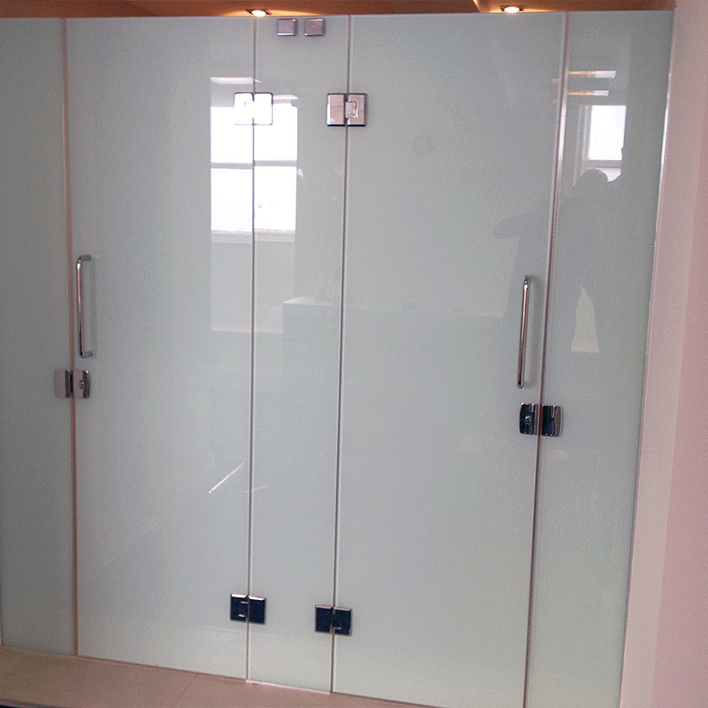 Coloured glass shower and toilet doors at a gym in London