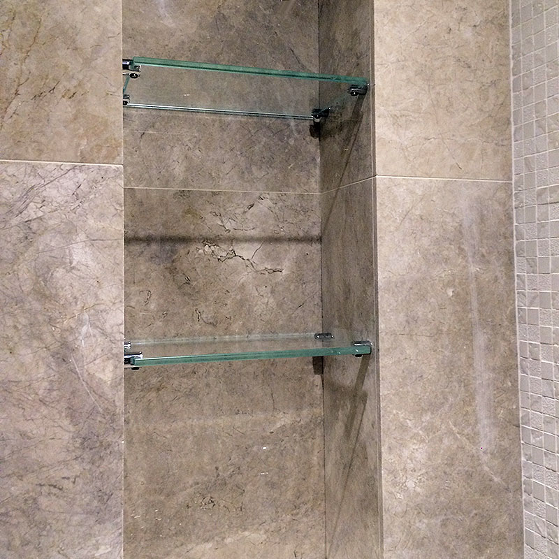 Recessed glass shelves in the shower
