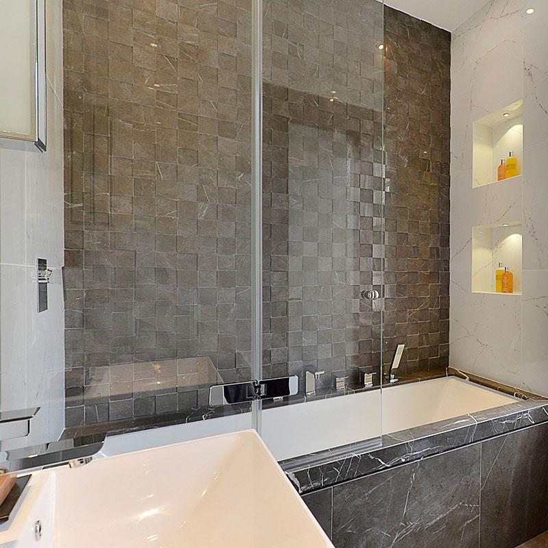 Frameless glass over bath