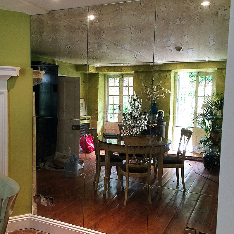 Dining room wall mirror with antique finish