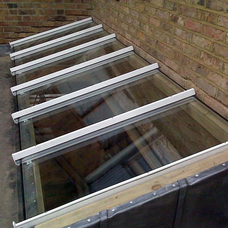 Toughened glass skylight installation in London