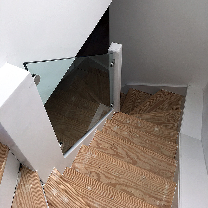 Bespoke glass balustrade in a stairwell
