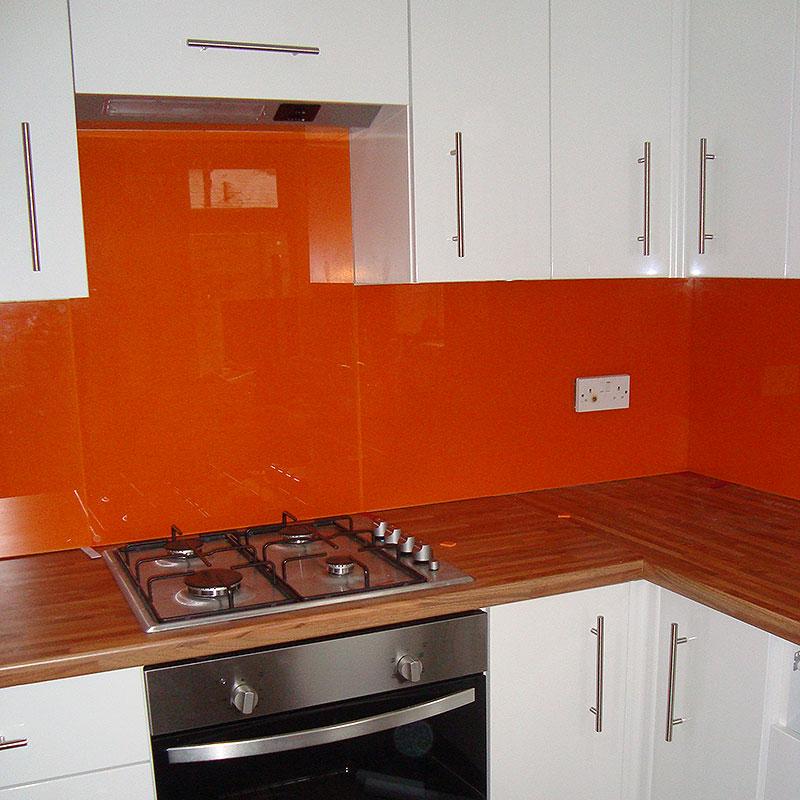 Bright orange kitchen splashbacks