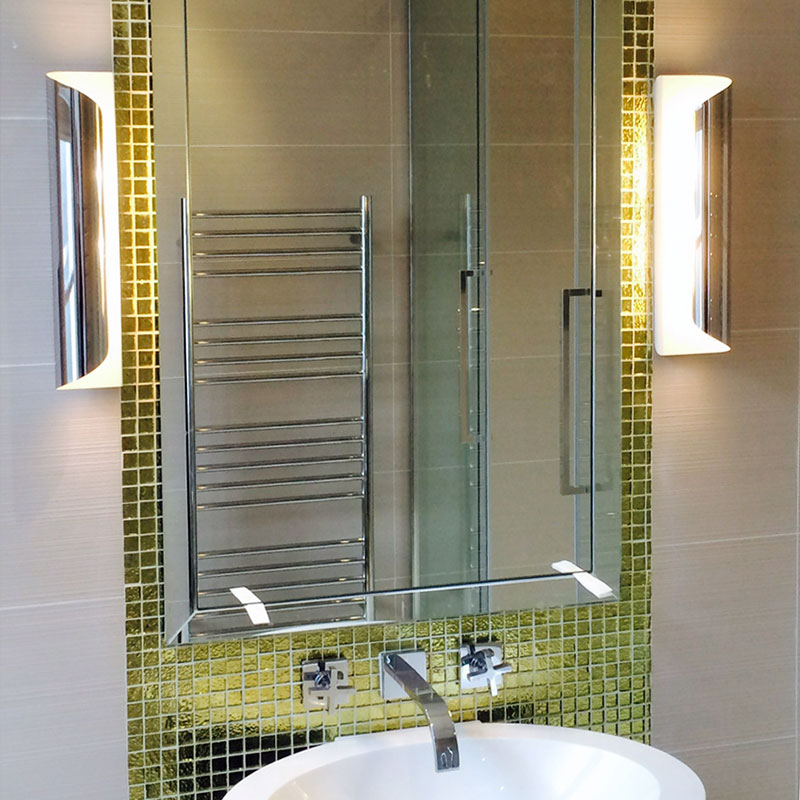 Tall bevelled edge bathroom mirror with gold surround