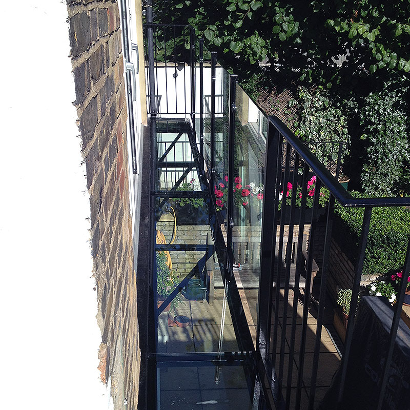 Glass balustrades on first floor exterior balcony in London