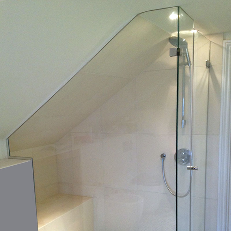 Shower glass cut to match curve of the roof