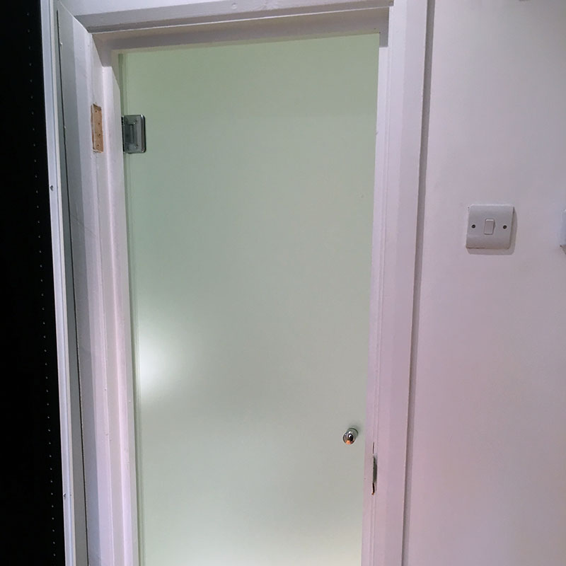 Frosted glass treatment room door in London