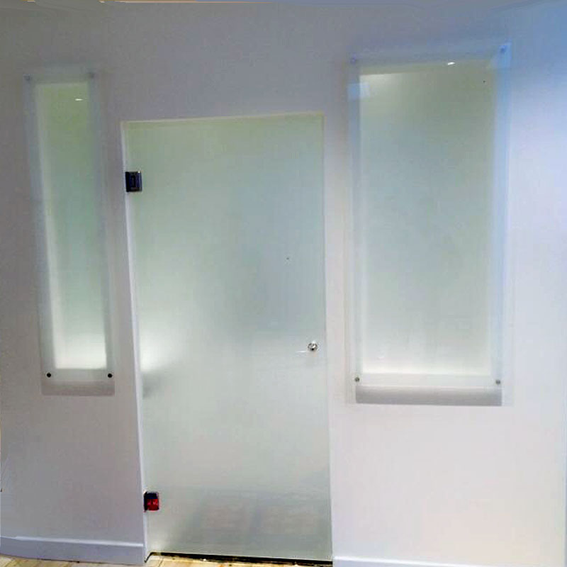 Frosted glass treatment room door and matching windows