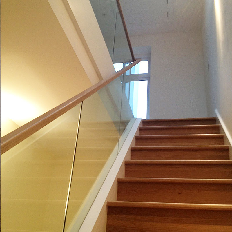 Light and modern glass balustrades give this home a classy feel