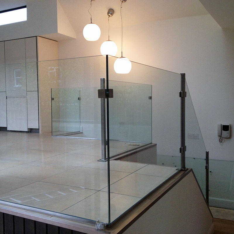 Glass balustrades surrounding kitchen mezzanine