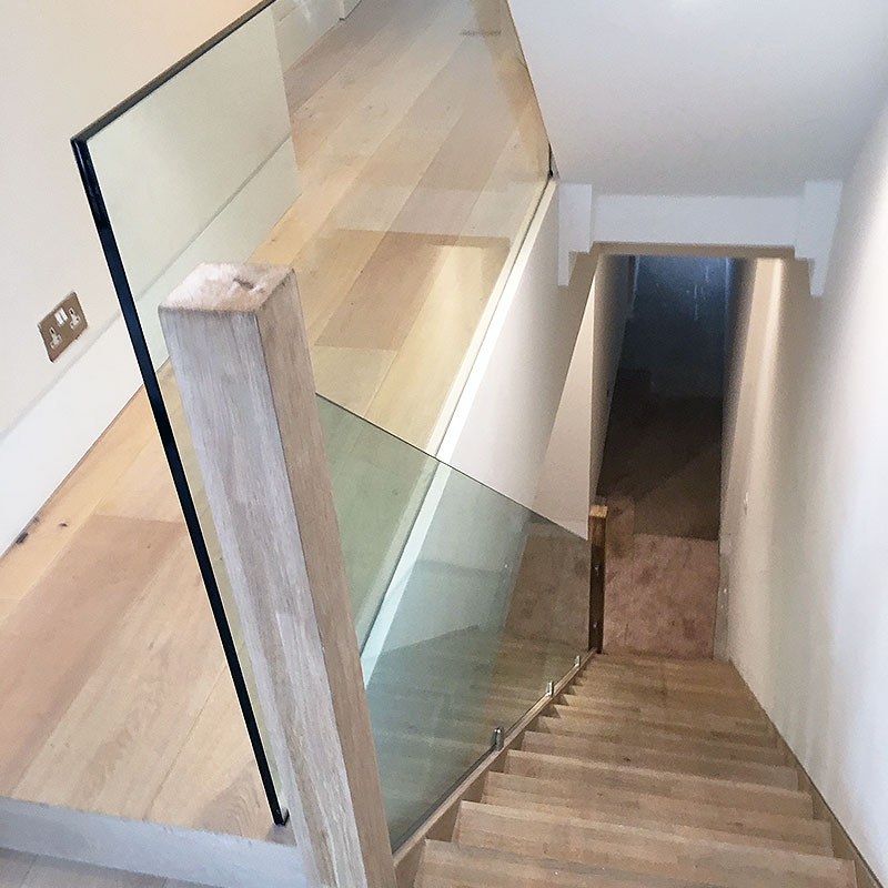 Glass frameless balustrades on interior stairwell