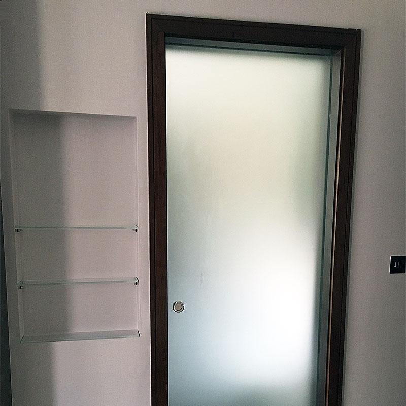 Glass door with glass shelving