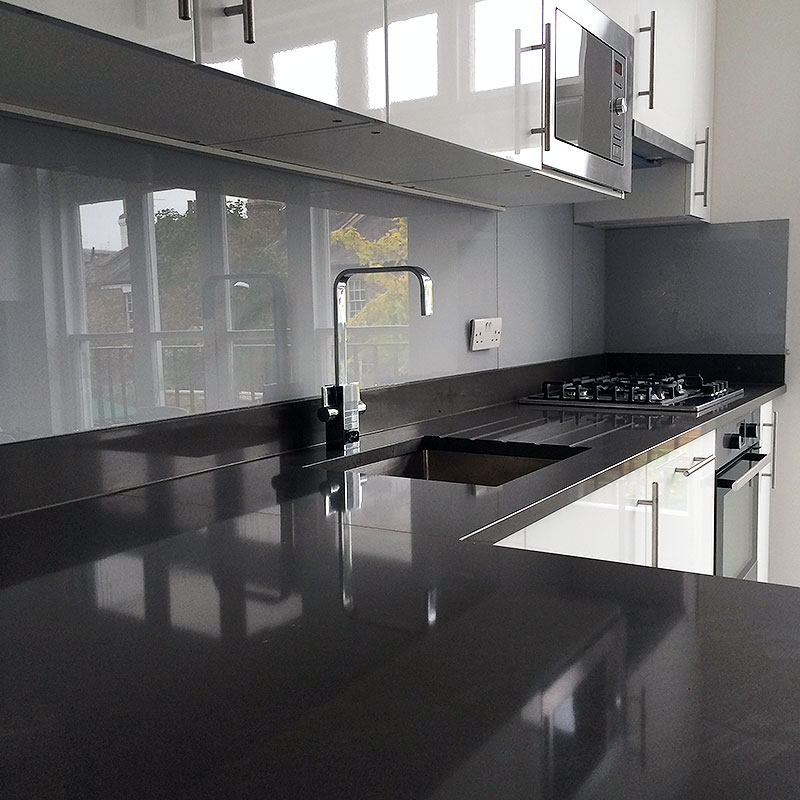 Pale glass kitchen splashback