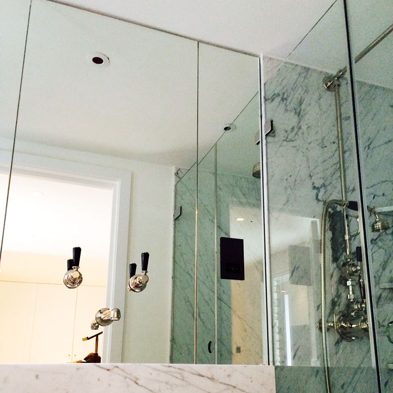 Bathroom mirror with inset basin taps
