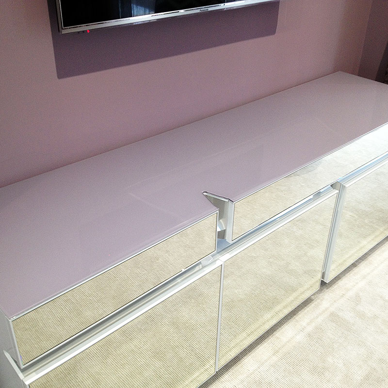 Mirror fronted and glass topped cabinet