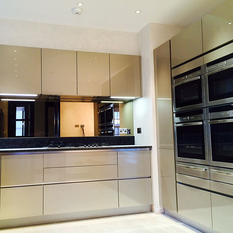 Mirrored glass kitchen splashback in Ladbroke Grover