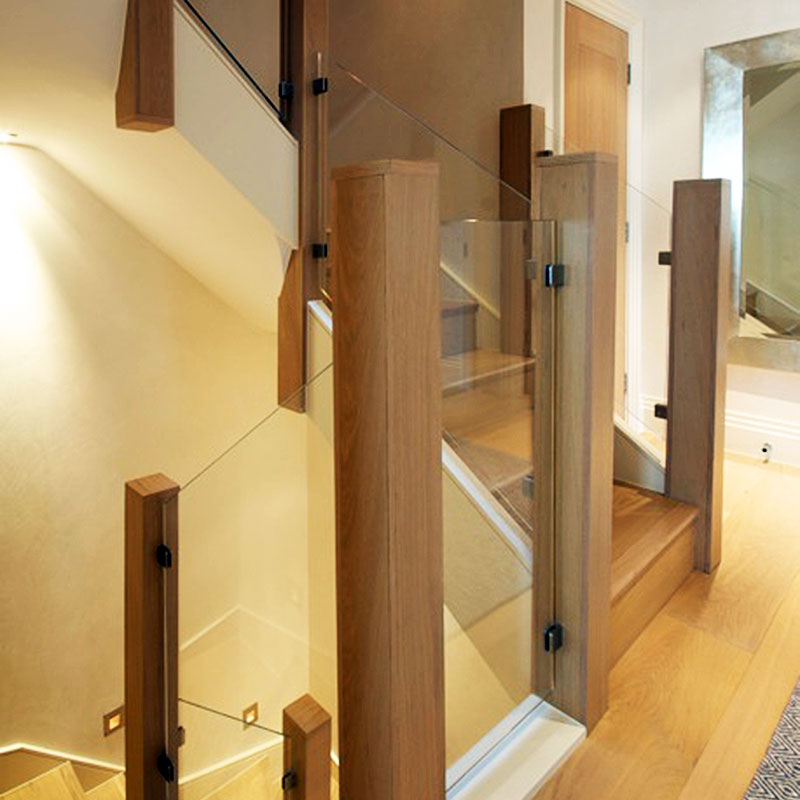 Wood and glass stairwell balustrades