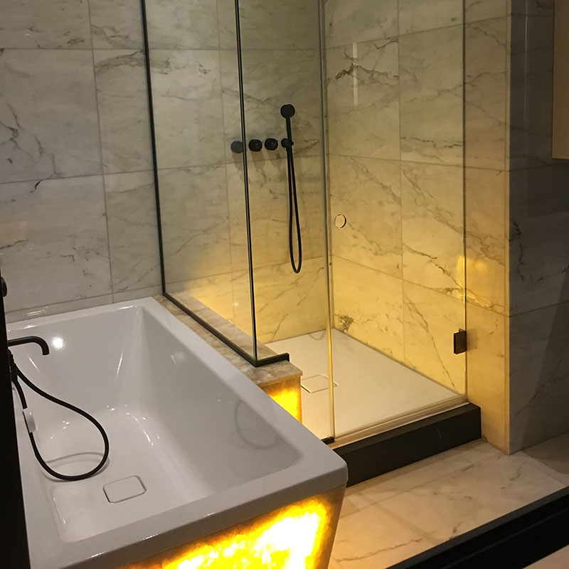 Frameless Shower with a glowing bath